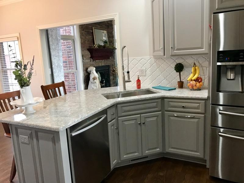 Kitchen Cabinets After Refinish by Ryan